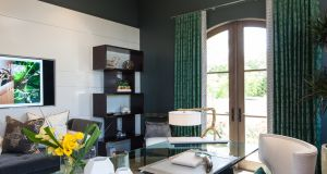 Lisa McDennon Design, based in Orange County, California, has mined the gemstone adventurine for her inspiration for this office belonging to Philharmonic House of Design. The walls are painted in several coats of Farrow and Ball Green Smoke, while the curtain fabrics were sourced from Beacon Hill Design. The sea- urchin-style pendant light is called Uni, available from Troy Lighting in the US. <br> lisamcdennon.com  farrow-ball.com  beaconhilldesign.com troy-lighting.com