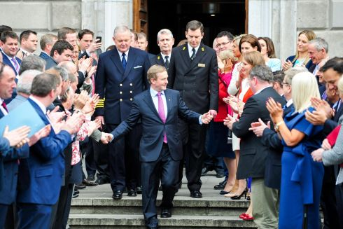 Enda Kenny greets well-wishers outside Leinster House. Photograph: Aidan Crawley