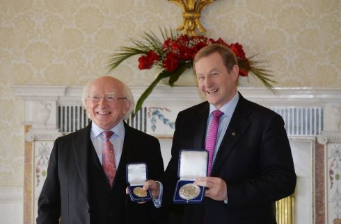 Enda Kenny recieves his seal of office from President Higgins. Photograph: Alan Betson
