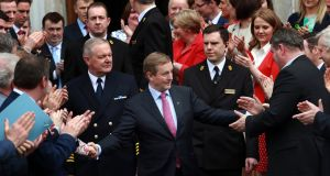 Newly elected Taoiseach  Enda Kenny is  congratulated as he leaves the Dail after becoming the first Fine Gael leader to be re-elected as Taoiseach. Photograph: The Irish Times