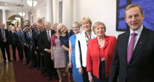 Taoiseach Enda Kenny stands in Government Buildings with members of the new Cabinet. Photograph: Merrion Street