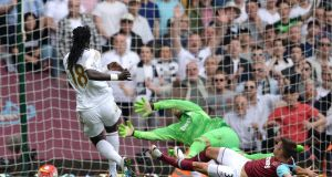 Bafetimbi Gomis scores Swansea's fourth in their 4-1 win over West Ham at Upton Park. Photograph: PA