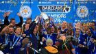 Wes Morgan lifts the Premier League trophy after Leicester City's 3-1 win over Everton. Photograph: PA