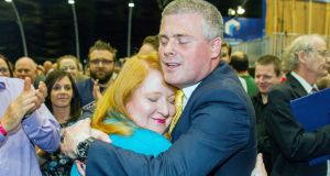 Naomi Long of the Alliance Party is congratulated by her husband Michael Long after being elected as MLA for Belfast East. Photograph: Liam McBurney/PA