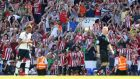 Southampton celebrate their second goal in front of the travelling support at White Hart Lane. Photograph: PA