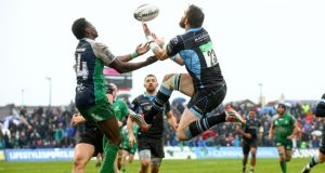 Connacht's Niyi Adeolokun and Glasgow's Sean Lamont contest a high ball at the Sportsground. Photograph: James Crombie/Inpho