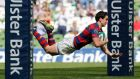 Man-of-the-match Joey Carbery dives over for a score in Clontarf's final win. Photograph: Inpho