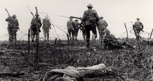 First day of Battle of the Somme: July 1st 1916. Soldiers go over the top and through the barbed wire to attack the Germans. Still from film made to commemorate the battle later in 1916. Photograph: The Art Archive/Imperial War Museum