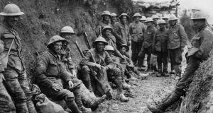Men of Royal Irish Rifles resting in a communication trench during the opening hours of the Battle of the Somme, July 1st 1916. Photograph: Royal Engineers no 1 Printing Company/IWM via Getty Images.