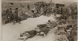 Wounded Allied soldiers lie on stretchers near the village of Ginchy, waiting for evacuation by horse-drawn ambulance. Photograph: Daily Herald Archive/SSPL/Getty Images