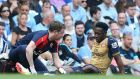 Arsenal's Danny Welbeck receives treatment after injuring a knee  during the  Premier League match against Manchester City at the Etihad Stadium. Photograph:   Martin Rickett/PA Wire