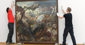 Staff members take down the triptych 'Der Krieg' (War) by Otto Dix, painted 1929-1932, in the Albertinum building at the Staatliche Kunstsammlungen for restoration on July 22, 2013 in Dresden, Germany. Photograph:  Matthias Rietschel/Getty Images)