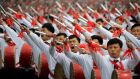 Parade participants beat drums as they march on the Kim Il Sung Square on Tuesday  in Pyongyang, North Korea. Photograph: Wong Maye-E/AP
