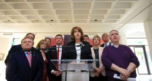 Joan Burton stamds  with party colleagues as she announces her decision to stand down as Labour leader at a press conference in Dublin. Photograph: Nick Bradshaw.