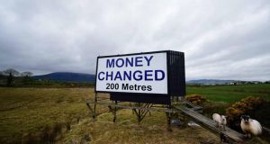 A billboard advertising pounds sterling to euros money changing services in Newry, Northern Ireland. One big Brexit danger is the possibility of new Border controls. Photograph: Charles McQuillan/Getty Images