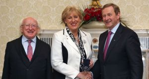 Minister for Regional Development, Rural Affairs, Arts and the Gaeltacht: Heather Humphreys  with President Michael D Higgins and Taoiseach Enda Kenny after receiving her seal of office. Photograph:  Colin Keegan, Collins