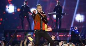 Nicky Byrne performing 'Sunlight' at the Ericsson Globe Arena in Stockholm. Photograph: Maja Suslin/AFP/Getty Images