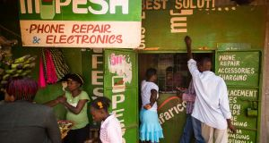 M-Pesa: millions of Kenyans use agencies like this one to transfer money by mobile phone. Photograph: Bloomberg