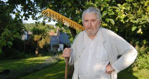 Aidan Higgins  in his garden in Kinsale, Co Cork residence. Photograph: Billy MacGill
