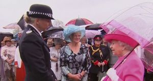 Overhead: Cmdr Lucy D'Orsi with Queen Elizabeth. Photograph: UK TV pool/PA