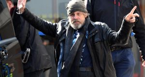 Mark Hamill (Luke Skywalker) reacts to the camera as Star Wars cast members arrive at Belfast International Airport on Friday Morning.  They are due to film Star Wars Episode VIII at   Malin Head in Co Donegal.  The entire shoot is very much top secret, with locals and landowners sworn to keep it that way, and access to the beauty spot is closed for the next three days.  Photograph: Colm Lenaghan/Pacemaker