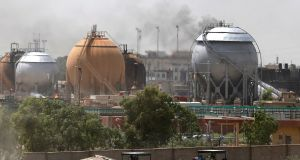 Smoke rises from gas storage tanks after a bomb attack against a state-run cooking gas factory in Taji at Baghdad's northern outskirts on Sunday. Photograph: Reuters