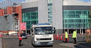 A bomb-disposal unit outside Old Trafford after the match between Manchester United and Bournemouth was abandoned. Photograph: Alex Livesey/Getty Images