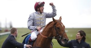 Frankie Dettori celebrates after riding Galileo Gold to win the Qipco 2000 Guineas Stakes at Newmarket. Photograph: Alan Crowhurst/Getty Images