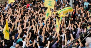 Hizbullah supporters carry the coffin of Mustafa Badreddine during his funeral in Beirut on Friday, May 13th. Photograph: Nabil Mounzer/EPA