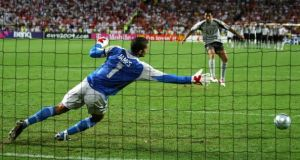 Portugal goalkeeper Ricardo scores the winning penalty against England in Lisbon in 2004. Photograph: Getty