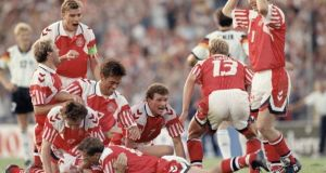 Kim Vilfort of Denmark is mobbed by team-mates after scoring the second and winning goal during the Euro 1992 final against Germany. Photograph: Getty