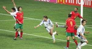 Angelos Charisteas wheels away after scoring the winner in the Euro 2004 final against hosts Portugal. Photograph: Getty