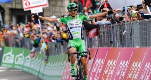 Italian cyclist Giulio Ciccone (Bardiani-CSF)  celebrates as he crosses the finish line to win the 10th stage of the Giro d'Italia from Campi Bisenzio to Sestola. Photograph: Luk Benies/AFP/Getty Images