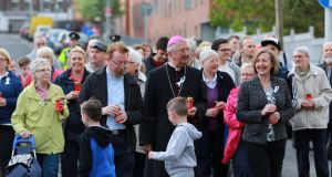 Catholic Archbishop of Dublin Diarmuid Marting flanked by locals on a march against the violence and neglect that has blighted the north inner city. Photograph: Nick Bradshaw