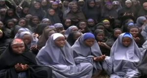 A  screengrab taken from a 2014 video of Nigerian Islamist extremist group Boko Haram showing schoolgirls abducted by Boko Haram from Chibok, wearing the full-length hijab and praying in an undisclosed rural location. Photograph: AFP.