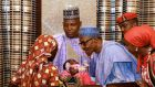 Nigerian president Muhammadu Buhari  with Boko Haram escapee Amina Ali Darsha Nkeki's   four-month-old baby   during a meeting in the   presidential villa in the country's capital  Abuja. Photograph:   Afolabi Sotunde/Reuters