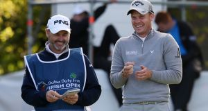 Danny Willett shares a joke with Lee Westwood's caddie Billy Foster  during the first round of the  Dubai Duty Free Irish Open  at  The K Club in Dtraffan. Photograph: Paul Childs/ Action Images via Reuters/Livepic