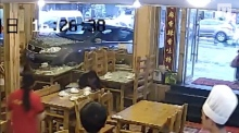 CCTV shows car ploughing into restaurant, narrowly missing diners