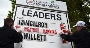 A Weather Warning is announced as play is suspended during the third round of the Dubai Duty Free Irish Open. Photo:  Ross Kinnaird/Getty Images