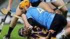 Wexford's Liam Óg McGovern is going nowhere with Dublin's Oisin Gough lying on top of him at Croke Park on Saturday evening. Photograph: Lorraine O'Sullivan/Inpho