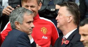 Out with the old, in with the new: Jose Mourinho and  Louis van Gaal.  Photograph: Martin Rickett/PA Wire.