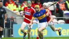 Tipperary's Kieran Bergin with Cork's Brian Lawton in the Munster quarter-final. Photograph: Inpho/Ken Sutton