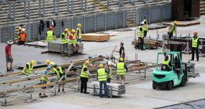 Riggers work on assembling the stage  at Croke Park in Dublin for this weekend's Bruce Stringsteen concerts.  Photograph: Colin Keegan/Collins Dublin