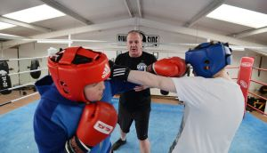 Young trainee boxers Brian and Michael Ward under the instruction of Philip Rooney, who set up the Navan boxing club. Photograph: Alan Betson / The Irish Times