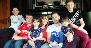 Debbie and Gary Devane with their children,  Zack (8), Ryan (17), Sophia and Pippa (4), and Josh (14), at their home in Portarlington, Co Laois. Photograph: James Flynn/APX