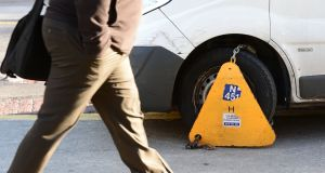 While three quarters of the 54,069 motorists clamped in the Dublin area in 2015 had not been clamped in the previous four years, 2,010 had been clamped between five and 50 times and two were clamped 54 times - an average of once every three or four weeks. File photograph: Alan Betson/The Irish Times