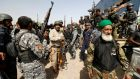 Shia fighters with Iraqi security forces gather near Falluja, Iraq, on Tuesday. Photograph: Thaier Al-Sudani/Reuters