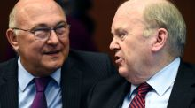 France's minister of finance and public accounts Michel Sapin (left) talks with  Minister for Finance Michael Noonan during a Eurogroup meeting in Brussels on May 24th. Photograph: John ThysAFP/Getty Images