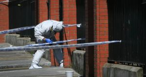 A garda searches for evidence after the killing of Gareth Hutch at North Cumberland Street, Dublin, May 24th, 206. Photo: Gareth Chaney/Collins