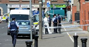 Gardaí and forensic experts at the scene of the fatal shooting of Gareth Hutch at North Cumberland Street in Dublin on Tuesday. Photograph: Eric Luke/The Irish Times